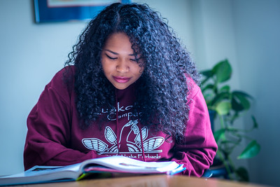 Kisha Lee, majoring in rural human services at UAF's Kuskoskim Campus in Bethel, studies in the student lounge on campus.  Filename: LIF-16-4859-134.jpg