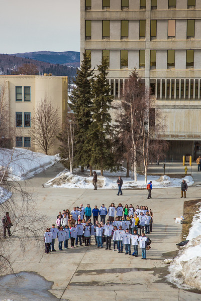 """Staff, faculty and students from UAF's School of Education form a human ribbon on a campus sidewalk to draw attention during National Autism Awareness week.  <div class=""""ss-paypal-button"""">Filename: LIF-13-3776-10.jpg</div><div class=""""ss-paypal-button-end"""" style=""""""""></div>"""