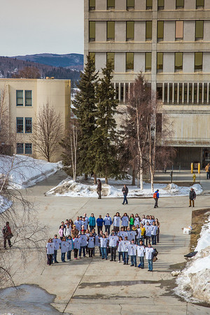 Staff, faculty and students from UAF's School of Education form a human ribbon on a campus sidewalk to draw attention during National Autism Awareness week.  Filename: LIF-13-3776-10.jpg