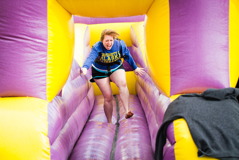 Morgan Poole races on a bungee run during UAF's 2012 Spring Fest field day activities