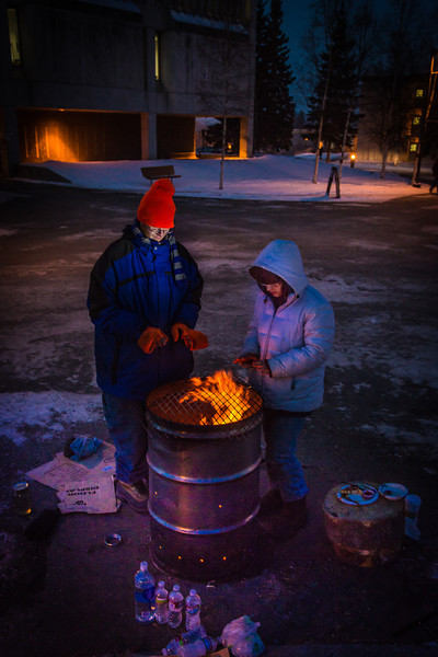 """Mathew Carrick and Sarah Azrael take their turn at the Honors Program homeless vigil Friday morning while the temperature hovered around -20°.  <div class=""""ss-paypal-button"""">Filename: LIF-12-3653-40.jpg</div><div class=""""ss-paypal-button-end"""" style=""""""""></div>"""