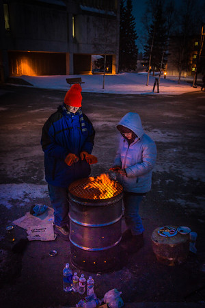 Mathew Carrick and Sarah Azrael take their turn at the Honors Program homeless vigil Friday morning while the temperature hovered around -20°.  Filename: LIF-12-3653-40.jpg