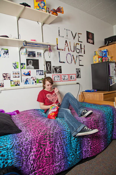 """Freshman Hailley Myers uses her mobile phone to check her Facebook page from her room in Skarland Hall.  <div class=""""ss-paypal-button"""">Filename: LIF-12-3322-167.jpg</div><div class=""""ss-paypal-button-end"""" style=""""""""></div>"""