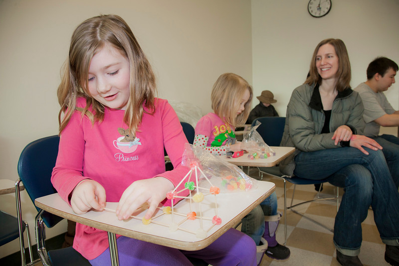 """Cadence and Andie Conner build gum drop bridges at the annual Eweek open house in the Duckering Building on campus.  <div class=""""ss-paypal-button"""">Filename: LIF-12-3302-38.jpg</div><div class=""""ss-paypal-button-end"""" style=""""""""></div>"""