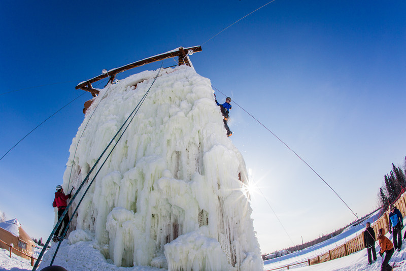 """Students take advantage of nice spring weather to try out their climbing skills on the new ice wall near the SRC.  <div class=""""ss-paypal-button"""">Filename: LIF-12-3321-139.jpg</div><div class=""""ss-paypal-button-end"""" style=""""""""></div>"""