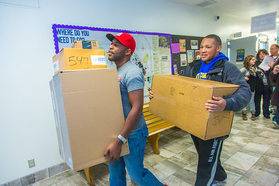 Returning students, staff and parents all pitch in to help new arrivals move into the residence halls during Rev It Up on the Fairbanks campus at the beginning of the fall 2015 semester.  Filename: LIF-15-4636-171.jpg