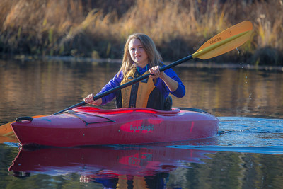 Business major Shelby Carlson enjoys a morning paddle on Ballaine Lake.  Filename: LIF-12-3562-042.jpg