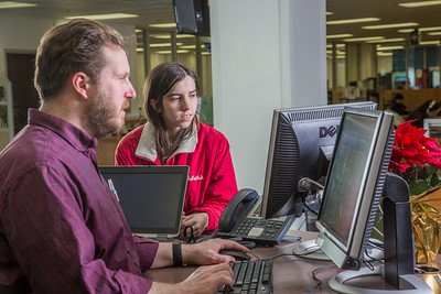 Staff librarian Paul Adasiak, left, helps justice major Kristie Major with a reference question in the UAF Rasmuson Library on the Fairbanks campus.  Filename: LIF-14-4045-192.jpg