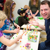 "Engineering student Andrew Chamberlain helps out young engineers build their gumdrop bridges during the during the E-Week open house in the Duckering Building.  <div class=""ss-paypal-button"">Filename: LIF-13-3741-54.jpg</div><div class=""ss-paypal-button-end"" style=""""></div>"