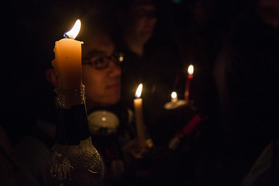 Students commemorate the 1957 Tradition Stone candlelight vigil on Constitution Park in March of 2013.  Filename: LIF-13-3763-40.jpg