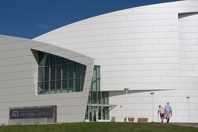 An elderly couple walks to the Museum of the North the day after the summer's solstice.  Filename: LIF-12-3445-4.jpg