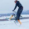 "Students take advantage of some free time during finals week to try out their modified ski-bike on the hill below the IAB greenhouse.  <div class=""ss-paypal-button"">Filename: LIF-11-3246-25.jpg</div><div class=""ss-paypal-button-end"" style=""""></div>"