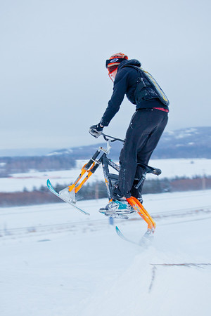 """Students take advantage of some free time during finals week to try out their modified ski-bike on the hill below the IAB greenhouse.  <div class=""""ss-paypal-button"""">Filename: LIF-11-3246-25.jpg</div><div class=""""ss-paypal-button-end"""" style=""""""""></div>"""