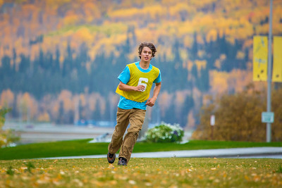 Mechanical engineering major Adam McCombs warms up for a bout of utlimate frisbee in the field near the University of Alaska's Museum of the North on a fall afternoon.  Filename: LIF-12-3557-107.jpg