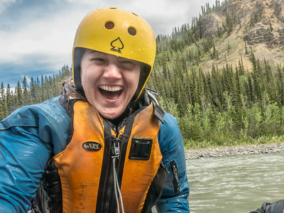 UAF Wellness Coordinator Kaydee Miller is exhilarated after a drip during an Outdoor Adventures raft trip down the Nenana River in June, 2014.  Filename: OUT-14-4211-146.jpg