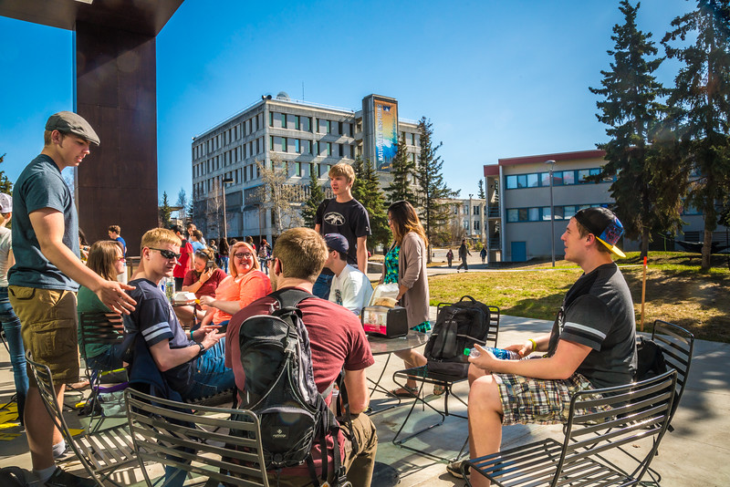 """Students enjoy some spring sunshine and warm temperatures in late April on the Fairbanks campus.  <div class=""""ss-paypal-button"""">Filename: LIF-16-4877-30.jpg</div><div class=""""ss-paypal-button-end""""></div>"""