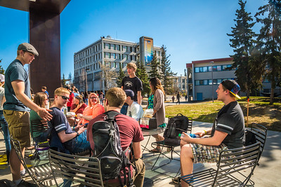 Students enjoy some spring sunshine and warm temperatures in late April on the Fairbanks campus.  Filename: LIF-16-4877-30.jpg