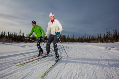 UAF students Ian Wilkinson and Raphaela Sieber enjoy a morning loop around the campus ski trails.  Filename: LIF-12-3348-54.jpg