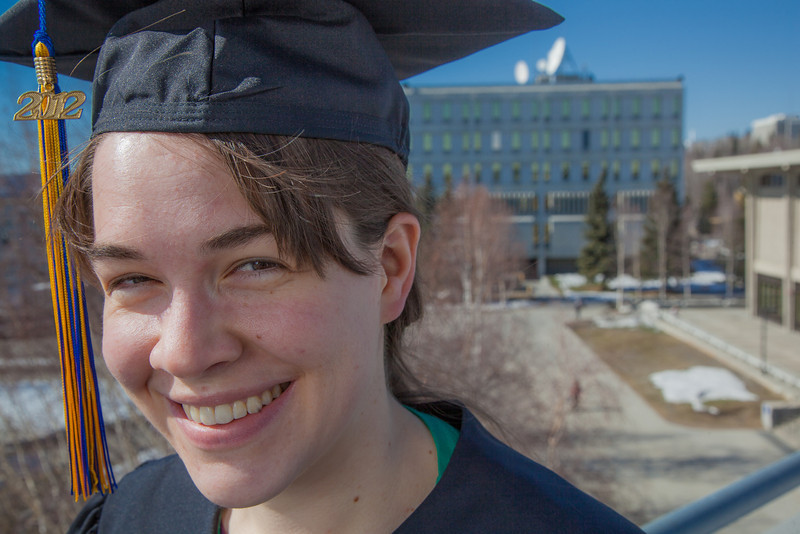 """Senior foreign languages major Lindsey Miller poses in her cap and gown on the roof of the Brooks Building on the Fairbanks campus.  <div class=""""ss-paypal-button"""">Filename: LIF-12-3352-91.jpg</div><div class=""""ss-paypal-button-end"""" style=""""""""></div>"""
