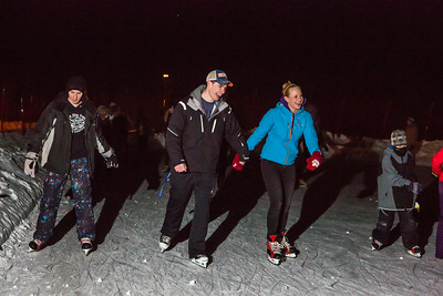 Students skate in an outdoor skating rink provided by DRAW.  Filename: LIF-14-4082-7.jpg