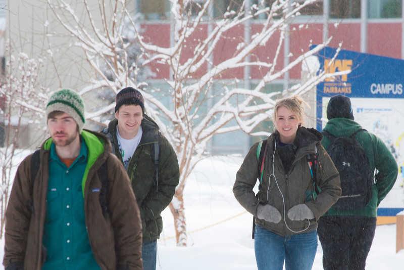 """Jaxon Hill (center) walks with Corey Day (left)  across campus between classes.  <div class=""""ss-paypal-button"""">Filename: LIF-12-3319-43.jpg</div><div class=""""ss-paypal-button-end"""" style=""""""""></div>"""