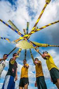 Participants in the quidditch club, UAF's newest intramural sport, pose after a competitive match during SpringFest 2012.  Filename: LIF-12-3382-77.jpg