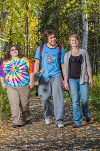 Grace Amundsen, left, Demetri Martin-Urban and Kaylie Wiltersen stroll through the woods near the west entrance to campus on a nice fall afternoon.  Filename: LIF-12-3544-136.jpg
