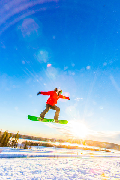 """Students enjoy some of the features of UAF's terrain park on a spring afternoon.  <div class=""""ss-paypal-button"""">Filename: LIF-13-3746-40.jpg</div><div class=""""ss-paypal-button-end"""" style=""""""""></div>"""