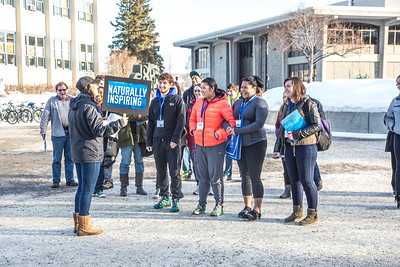 Admissions student employee Kelly Logue leads a group of prospective high school juniors and seniors on a campus tour during Inside Out event in March.  Filename: LIF-14-4116-50.jpg