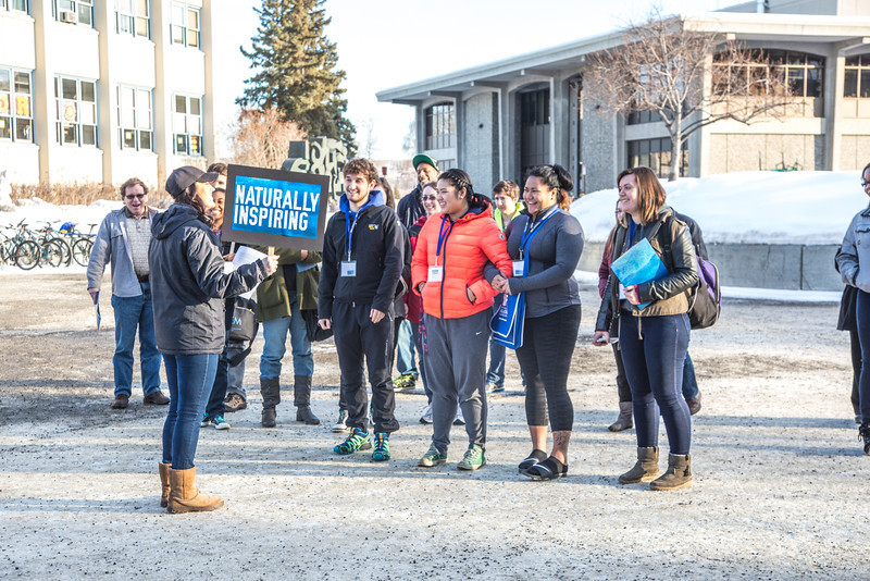 """Admissions student employee Kelly Logue leads a group of prospective high school juniors and seniors on a campus tour during Inside Out event in March.  <div class=""""ss-paypal-button"""">Filename: LIF-14-4116-50.jpg</div><div class=""""ss-paypal-button-end"""" style=""""""""></div>"""
