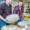 "Professor Jim Brashear, left, lifts a turkey into a roasting pan with assistance from art major Ian Wilkinson in the UAF Fine Arts complex. The unique cooking process has been perfected over the past 20 years by Brashear who hosts a feast each year for hungry students on campus over Thanksgiving break.  <div class=""ss-paypal-button"">Filename: LIF-12-3659-93.jpg</div><div class=""ss-paypal-button-end"" style=""""></div>"