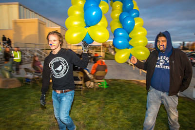 Jordan Lichtenberger, left, and Juan Cruz move balloons during festivities surrounding the Starvation Gulch celebration in front of the Patty Center.  Filename: LIF-12-3570-150.jpg