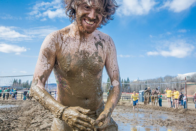 James Donohue poses after a round of mud volleyball during Spring Fest.  Filename: LIF-12-3376-171.jpg