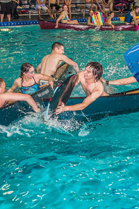 Battleship is a popular intramural sport at UAF. Teams in canoes try to swamp each other's boats during a tournament in the Patty pool.  Filename: LIF-13-3975-71.jpg