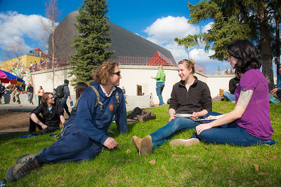 Nick Nyquist (left) Kirsten Olson (center) and Carly Varness (right) eat lunch on the lawn in front of the Wood Center during the Spring Fest kick off barbeque.  Filename: LIF-12-3375-37.jpg