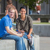 "New students Sean Crawford, left, and Roger Vang catch some sun between classes on the first day of the fall 2012 semester.  <div class=""ss-paypal-button"">Filename: LIF-12-3529-113.jpg</div><div class=""ss-paypal-button-end"" style=""""></div>"