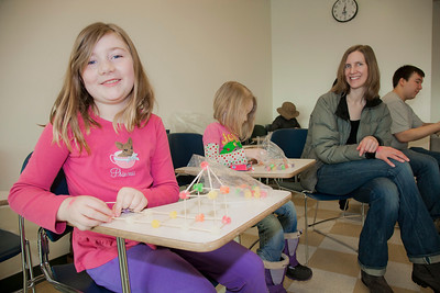 Cadence and Andie Conner build gum drop bridges at the annual Eweek open house in the Duckering Building on campus.  Filename: LIF-12-3302-40.jpg
