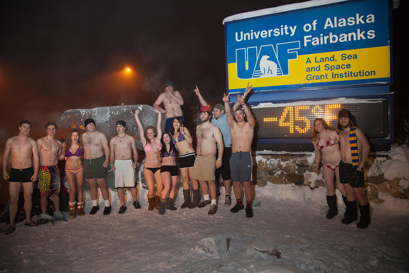 """A group of hardy UAF students join the 40°below club by posing in their shorts or swimsuits by the time &amp; temperature sign at an extreme temperature of 40° below or colder.  <div class=""""ss-paypal-button"""">Filename: LIF-12-3269-21.jpg</div><div class=""""ss-paypal-button-end"""" style=""""""""></div>"""