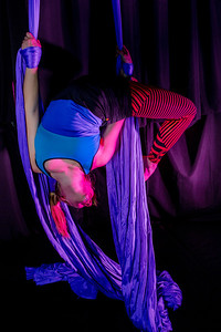 Teal Rogers is an active member of the silk club at UAF, in which members perform acrobatic stunts hanging from silks.  Filename: LIF-14-4133-105.jpg