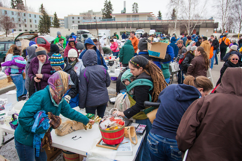 """People brave the cold at the Really Free Market, May 18, 2013 on campus.  <div class=""""ss-paypal-button"""">Filename: LIF-13-3844-31.jpg</div><div class=""""ss-paypal-button-end"""" style=""""""""></div>"""