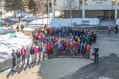 Staff and faculty from UAF's School of Education organized this human ribbon to raise awareness of autism which recent numbers indicate as risen to one in every 88 births in the U.S.  Filename: LIF-14-4127-8.jpg