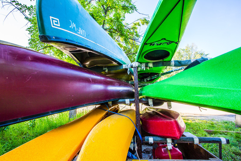 "Canoes and kayaks rest on racks near UAF's Wood Center when not being used by the Outdoor Adventures program.  <div class=""ss-paypal-button"">Filename: LIF-12-3476-07.jpg</div><div class=""ss-paypal-button-end"" style=""""></div>"