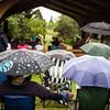 "People brave the weather with their umbrellas as they listen to music by the Opera Fairbanks Orchestra Brass at the Georgeson Botanical Garden as part of Summer Sessions' Music in the Garden series.  <div class=""ss-paypal-button"">Filename: LIF-13-3884-3.jpg</div><div class=""ss-paypal-button-end"" style=""""></div>"