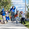 "New students on campus jump for a photograph on their way to the MBS complex Tuesday afternoon, August 28, 2012.  <div class=""ss-paypal-button"">Filename: LIF-12-3518-58.jpg</div><div class=""ss-paypal-button-end"" style=""""></div>"
