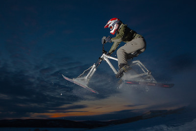 Engineering major Mike Stanfill tests out his modified ski-bike on the UAF sledding hill.  Filename: LIF-12-3305-7.jpg