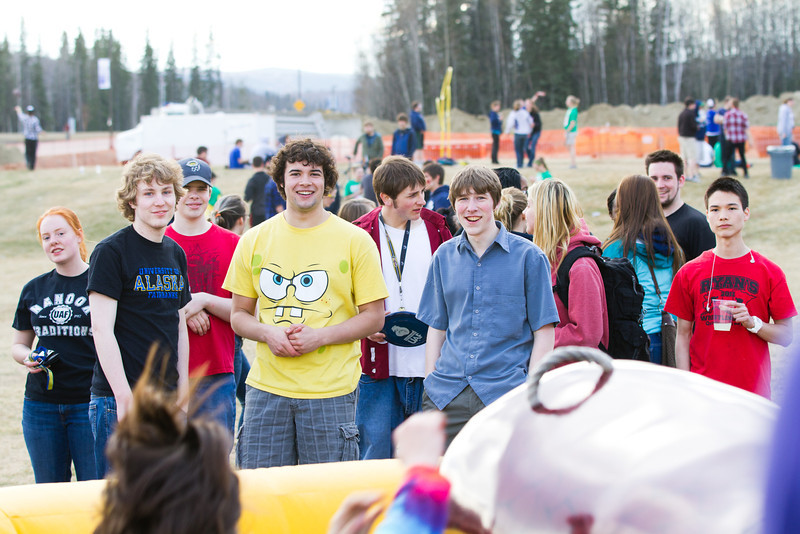 """Students watch the mechanical salmon during the 2012 Spring Fest field day activities.  <div class=""""ss-paypal-button"""">Filename: LIF-12-3384-254.jpg</div><div class=""""ss-paypal-button-end"""" style=""""""""></div>"""