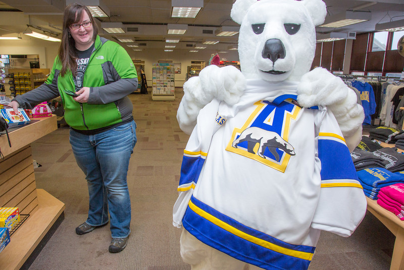 """The UAF mascot shops for some new clothes in the UAF Bookstore in Constitution Hall.  <div class=""""ss-paypal-button"""">Filename: LIF-14-4101-25.jpg</div><div class=""""ss-paypal-button-end"""" style=""""""""></div>"""