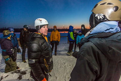Sam Braband, outdoor recreation manager for UAF's DRAW program (Department of Recreation, Adventure and Wellness) goes over rules with participants before the ice climbing competition during the 2014 Winter Carnival on campus.  Filename: LIF-14-4084-38.jpg