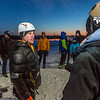 "Sam Braband, outdoor recreation manager for UAF's DRAW program (Department of Recreation, Adventure and Wellness) goes over rules with participants before the ice climbing competition during the 2014 Winter Carnival on campus.  <div class=""ss-paypal-button"">Filename: LIF-14-4084-38.jpg</div><div class=""ss-paypal-button-end"" style=""""></div>"