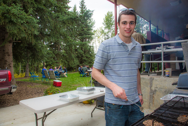 "Quinn Sawyer takes a turn flipping burgers on the grill during the Honors House annual welcome barbeque.  <div class=""ss-paypal-button"">Filename: LIF-12-3523-09.jpg</div><div class=""ss-paypal-button-end"" style=""""></div>"